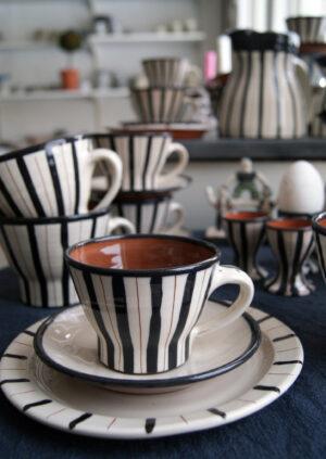 svart randig kopp